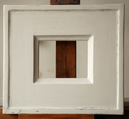 A frame covered with acrylic gesso, ready to begin gilding process.